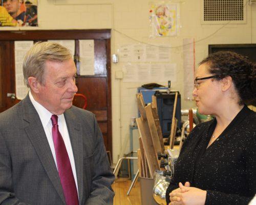 Sen. Durbin listens to Erica provide details on the program